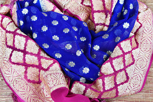 Blue georgette banarasi dupatta with small buta all over. Perfect to pair with any anarkali or lahenga.- blue with pink border