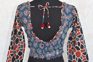 Shop this traditional Indian ajrakh print blue and red  cotton blouse online or from our store in near NYC. It is perfect for any wedding or engagement party.  Back View.