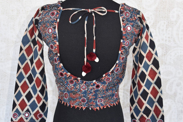 Shop this traditional Indian blue and red cotton designer blouse from Pure Elegance online or from our store in USA. Ideal for any wedding or reception party.  Back View.