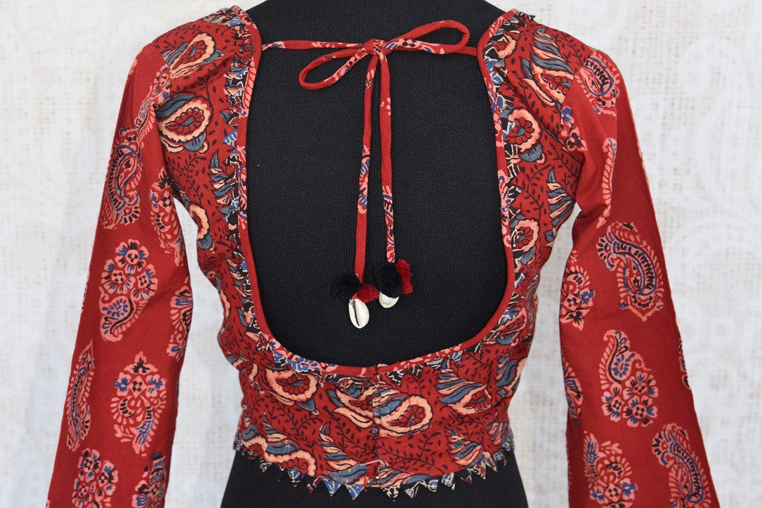 Buy this Indian traditional full sleeved red cotton print blouse from Pure Elegance online or from our store in USA. Perfect for any engagement or sangeet party. Back View.
