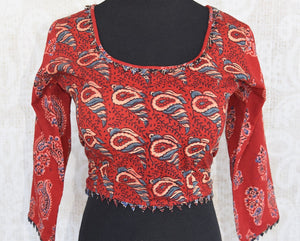 Buy this Indian traditional full sleeved red cotton print blouse from Pure Elegance online or from our store in USA. Perfect for any engagement or sangeet party. Front View.