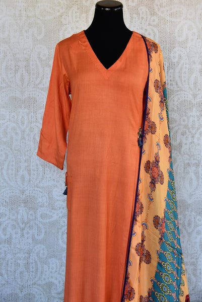 402023, Shop this Indian traditional orange cotton-silk dress from Pure Elegance with printed dupatta online or from our store in USA. Perfect for any wedding, reception or engagement. Top View.