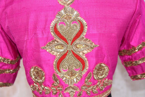Buy this ethnic Indian round neck embroidered silk designer blouse from Pure Elegance online or from our store in Edison, near NJ. It is perfect for any wedding. Close up.
