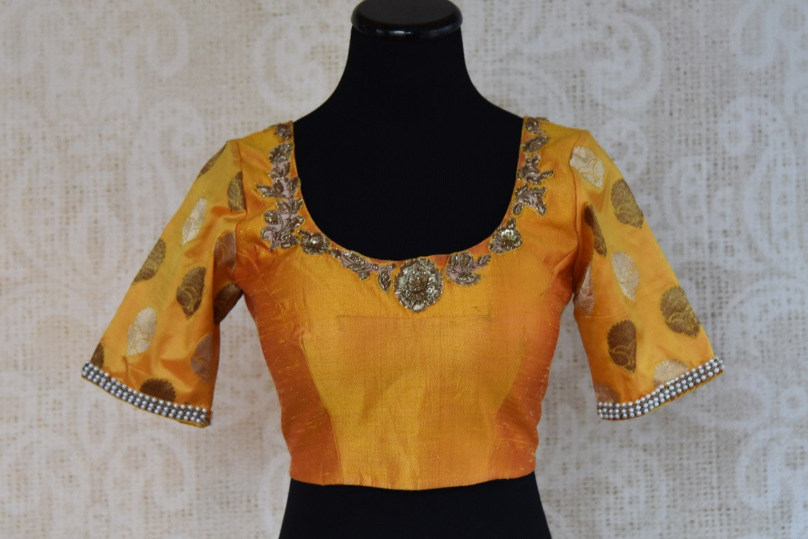 Shop this traditional Indian yellow silk designer blouse from Pure Elegance online or from our store in near NYC. It is perfect for any sangeet or prom party.  Front View.
