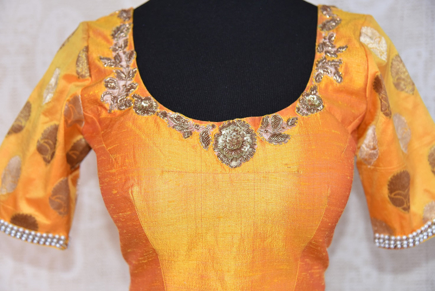 Shop this traditional Indian yellow silk designer blouse from Pure Elegance online or from our store in near NYC. It is perfect for any sangeet or prom party. Top View.