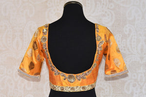 Shop this traditional Indian yellow silk designer blouse from Pure Elegance online or from our store in near NYC. It is perfect for any sangeet or prom party. Back View.