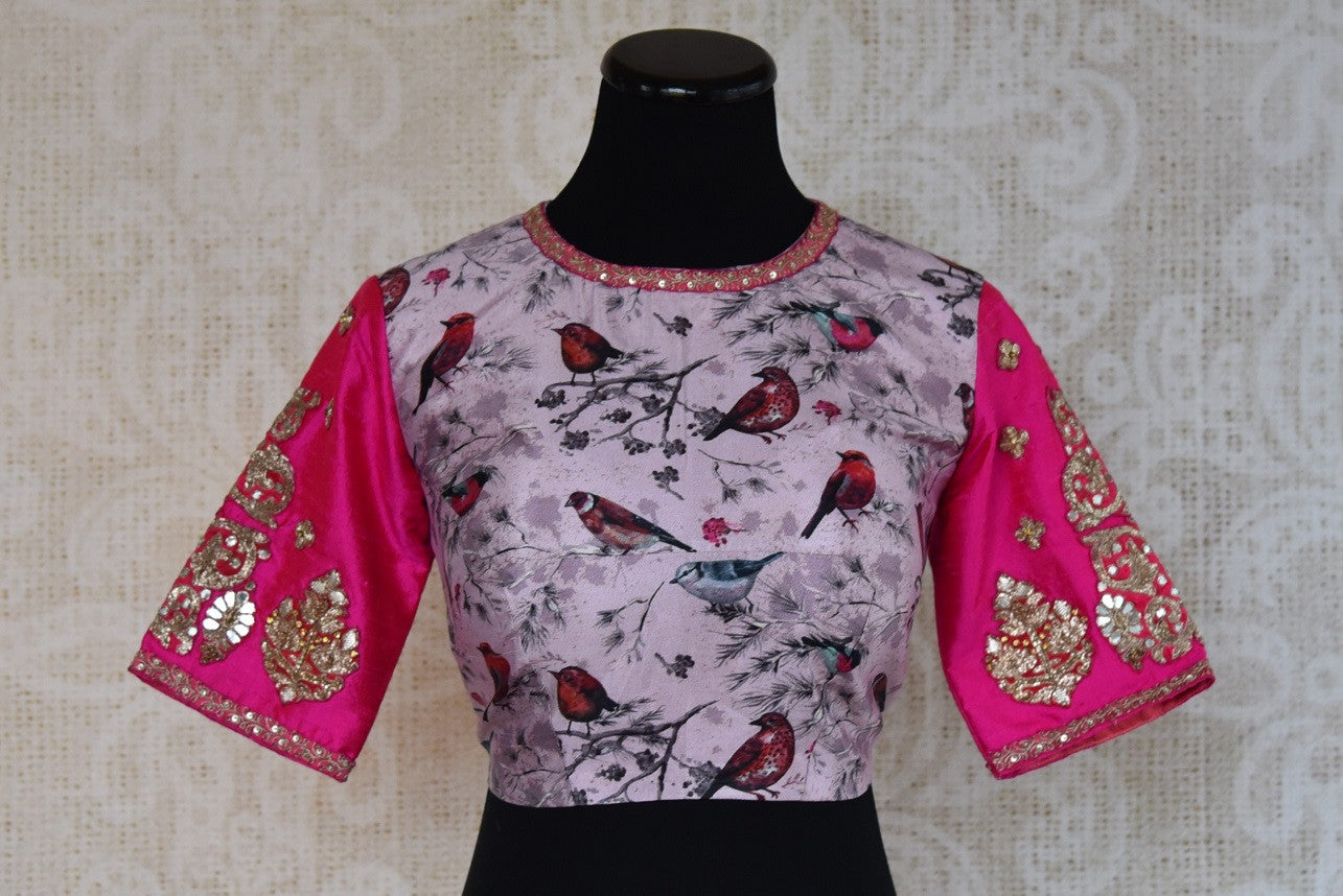 Buy this traditional Indian pink printed embroidered blouse from Pure Elegance online or from our store in USA. It is perfect for any sangeet party or wedding. Front View.
