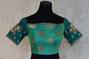 Shop this traditional Indian banarasi silk designer blouse from Pure Elegance online or from our store in USA. It is perfect for any wedding or reception party. Front View.