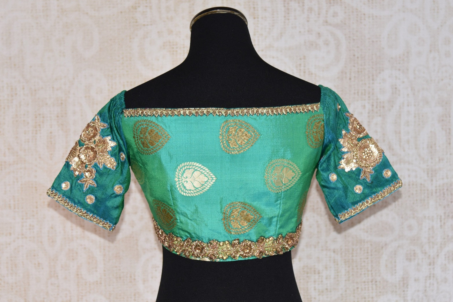 Shop this traditional Indian banarasi silk designer blouse from Pure Elegance online or from our store in USA. It is perfect for any wedding or reception party. Close up.