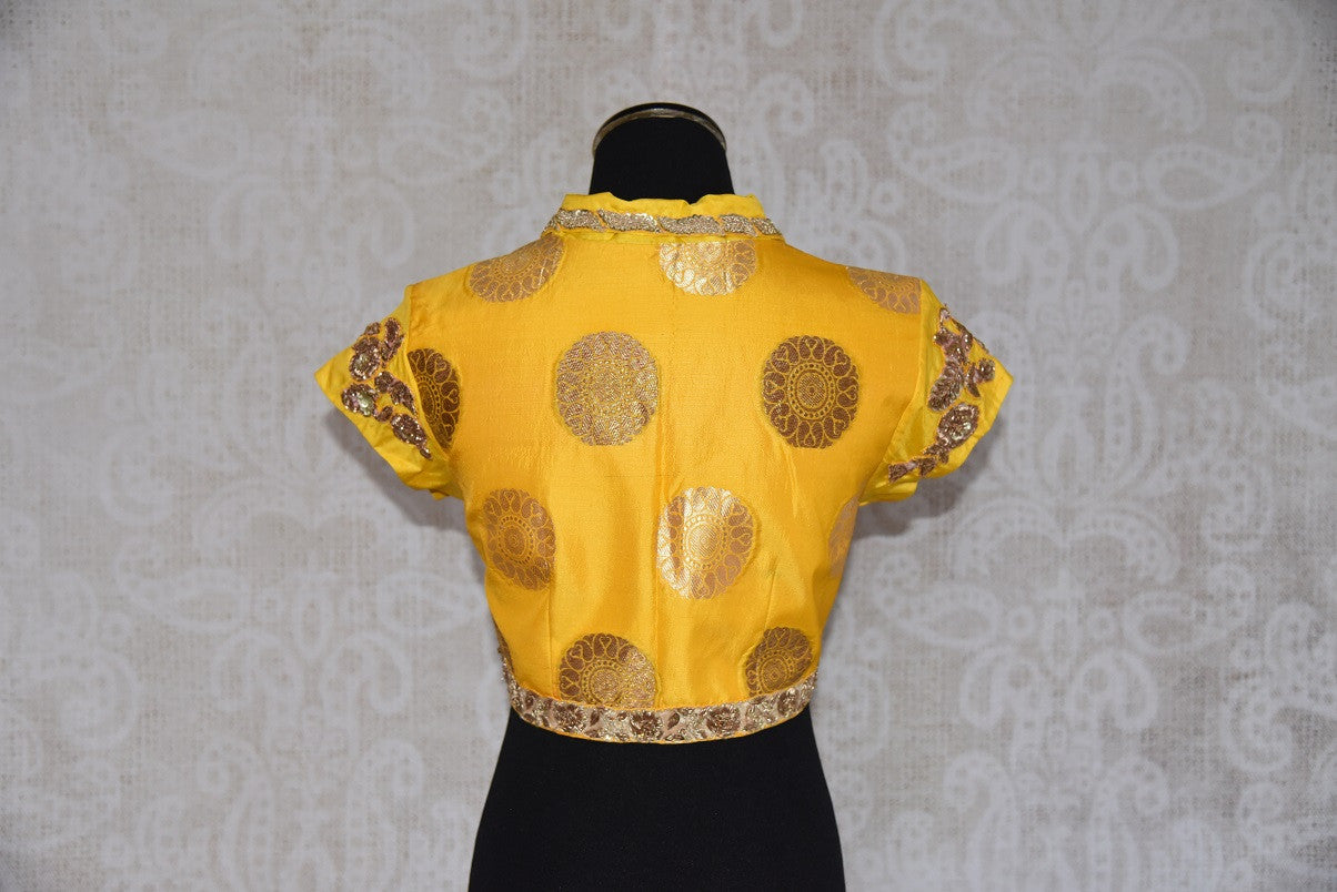 Buy this Indian traditional embroidered banarasi silk designer blouse from Pure Elegance is perfect for sangeet or puja. Buy it online or from our store in USA. Back View.