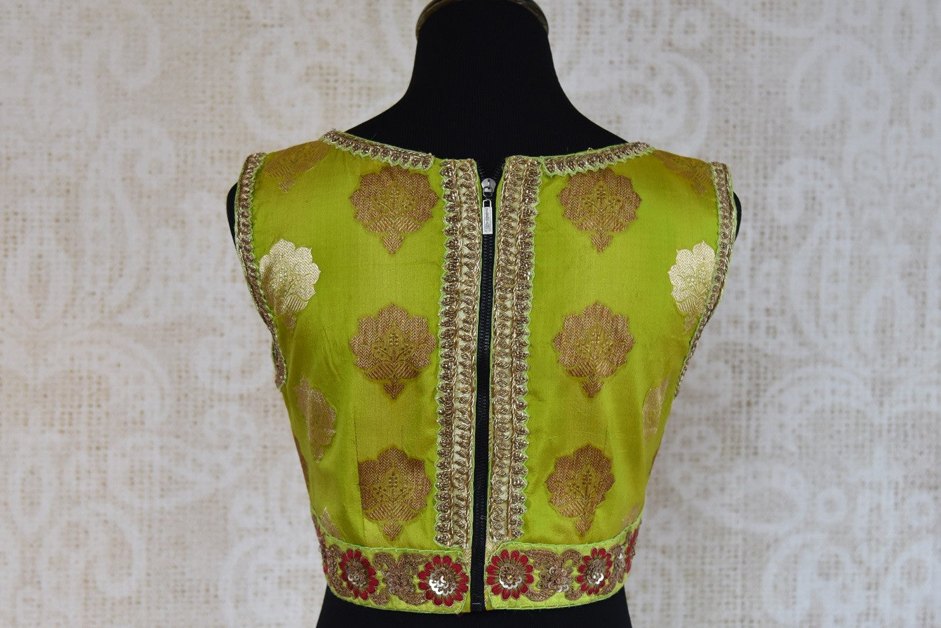 Shop this traditional Indian green banarasi embroidered blouse from Pure Elegance online or from our store in USA. Perfect for any wedding or reception party. Back View.