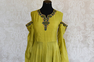 Designer Cotton silk green dress with  thread embroidery on neck and sleeves.Perfect evening party wear.-details