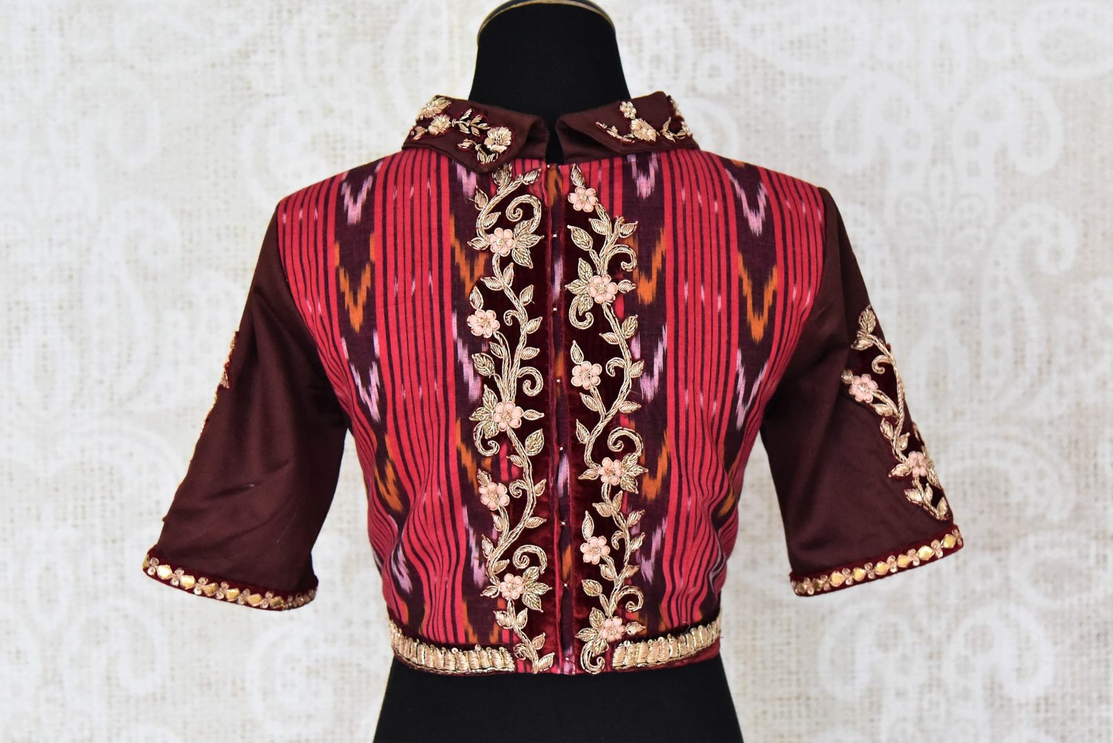 Buy maroon ikkat cotton silk embroidered saree blouse online in USA. Elevate your traditional Indian sarees with matching and contrasting readymade saree blouses from Pure Elegance Indian clothing store in USA.-back