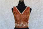 Orange ikkat printed pre-stitched blouse with zari embroidery V-neck blouse. Pair with solid saree and skirt.-front