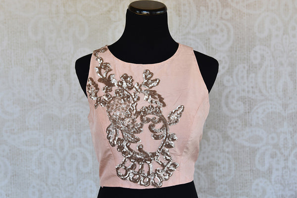 Pink with silver embroidery pre stitched silk blouse. Classy modern look blouse, perfect to match with saree. -front