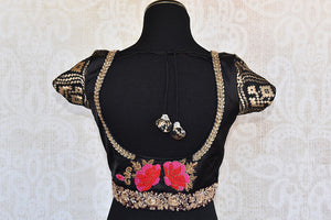Classy black designer silk blouse with thread embroidery in front and back. Ethnic look deep neck blouse.-back