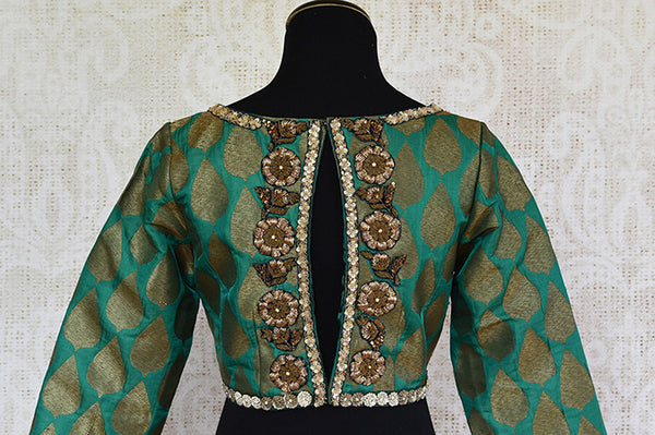 Green pre stitched embroidered banarasi silk blouse. Pair this with any silk saree or skirt.-back