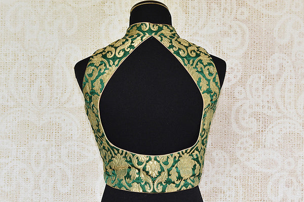 Glamorous green banarasi silk blouse available at Indian women clothing store Pure Elegance in Edison, New jersey. Pair this blouse with any solid saree, skirt.-back