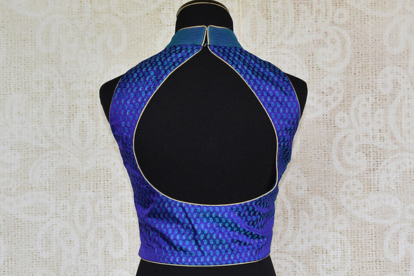 Blue banarasi silk pre stitched designer blouse. Pair this readymade blouse with any saree and lahenga.-back
