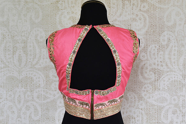 Pretty pink pre stitched designer blouse. Perfect in parties when you pair with saree.-Back
