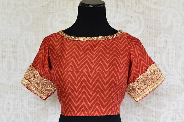 Red maroon cotton silk pre stitched blouse with gold embroidery. Perfect blouse in this fashion era-front