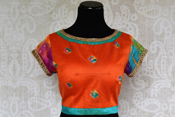 Buy this elegant orange embroidered silk sari blouse, decorated with light blue designs as well as several other colors. Available from Pure Elegance online USA store. - front