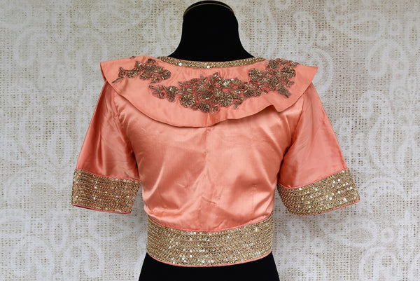 Buy this stunning pink silk sari blouse with elegant gold embroidery. Available through Pure Elegance online USA store. - back