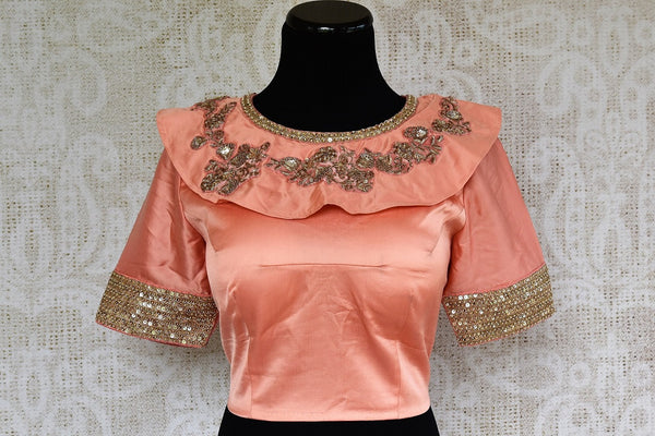 Buy this stunning pink silk sari blouse with elegant gold embroidery. Available through Pure Elegance online USA store. - front