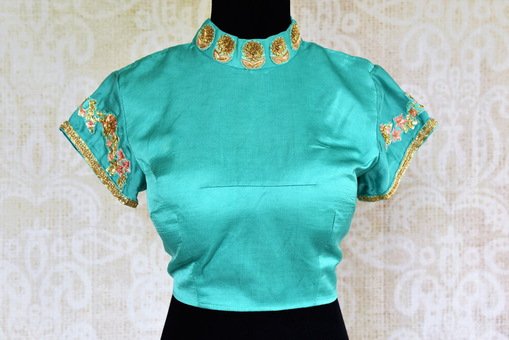 Buy blue embroidered silk blouse online in USA at Pure Elegance. Our Indian fashion store brings an exclusive collection of readymade designer blouses for women.-front