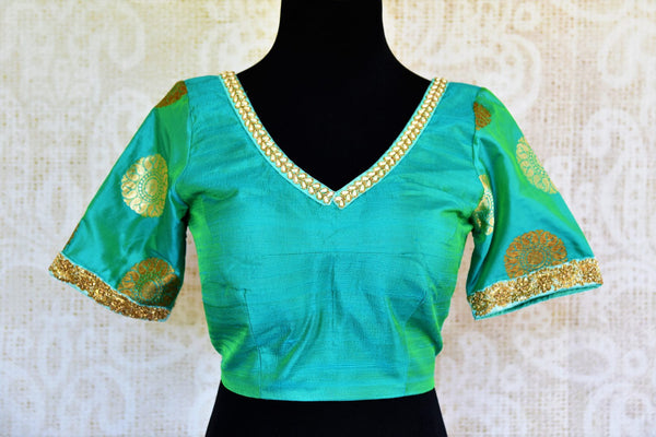 Buy green embroidered silk blouse online in USA with zari buta sleeves. Pure Elegance fashion store presents a range of ready-made designer sari blouses in USA.-front
