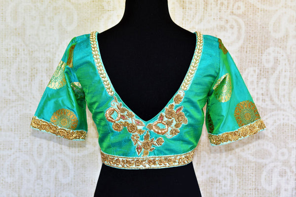 Buy green embroidered silk blouse online in USA with zari buta sleeves. Pure Elegance fashion store presents a range of ready-made designer sari blouses in USA.-back