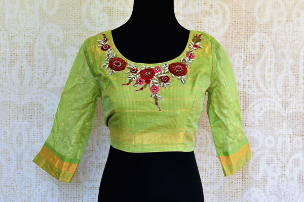 Buy green embroidered chanderi blouse online in USA. Pure Elegance fashion store brings an exquisite range of Indian readymade saree blouses in USA for women.-front
