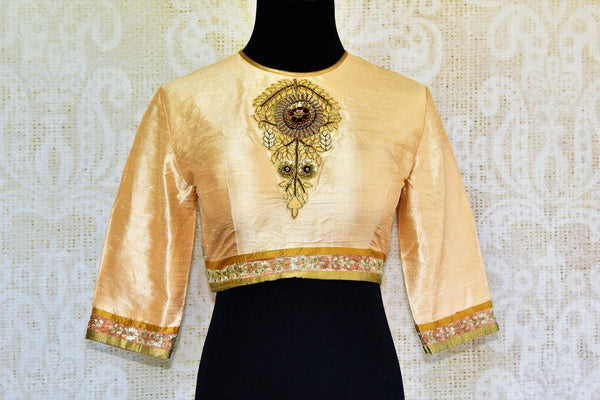 Buy gold raw silk embroidered saree blouse online in USA. Pure Elegance fashion store brings an alluring range of Indian readymade sari blouses in USA for women.-front