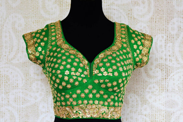 Green silk embroidered saree blouse for online shopping in USA. Pure Elegance clothing store brings an exquisite range of Indian readymade saree blouses in USA for women.-front