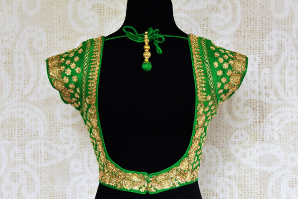 Green silk embroidered saree blouse for online shopping in USA. Pure Elegance clothing store brings an exquisite range of Indian readymade saree blouses in USA for women.-back