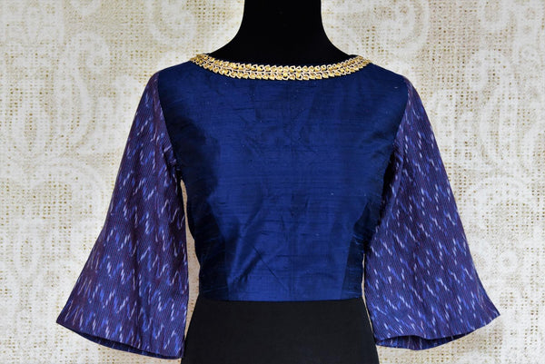 Dark blue raw silk embroidered saree blouse for online shopping in USA. Pure Elegance clothing store brings an exquisite range of Indian sari blouses in USA for women.-front