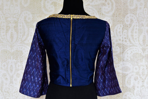 Dark blue raw silk embroidered saree blouse for online shopping in USA. Pure Elegance clothing store brings an exquisite range of Indian sari blouses in USA for women.-back