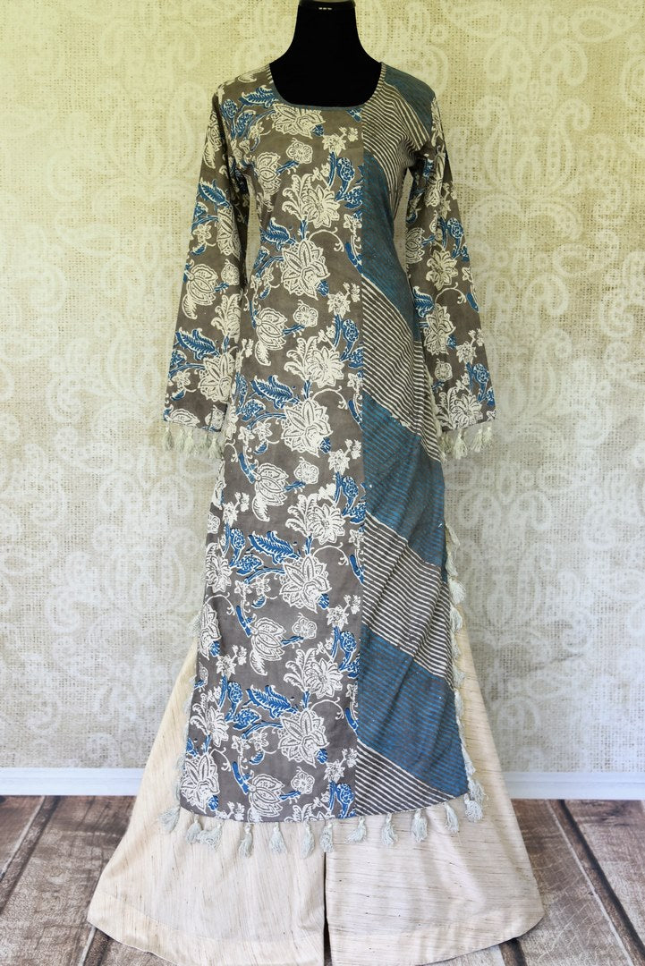 Strut in style to shopping avenues in our handprinted grey and blue long kurta. Pair it with our playful pair of cotton palazzo pants to add a fashion twist. A summer-friendly outfit, take this to work or outings. Shop designer silk saris, salwar suits, lehenga sets online or visit Pure Elegance store, USA.-full view