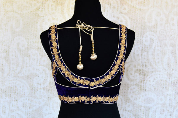 Buy blue velvet embroidered saree blouse online in USA. Pure Elegance clothing store brings an alluring range of Indian designer saree blouses in USA. Shop online.-back