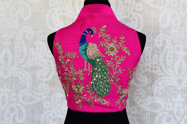 Buy bright pink embroidered sleeveless sari blouse online in USA. Match your sarees with latest designer blouses at Pure Elegance Indian clothing store in USA..-back