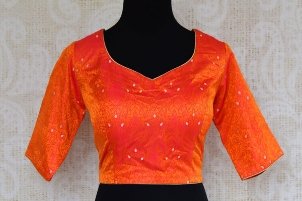 Buy bright orange Banarasi silk saree blouse online in USA. Pure Elegance clothing store brings an exquisite range of Indian saree blouses in USA for women. Shop online.-front