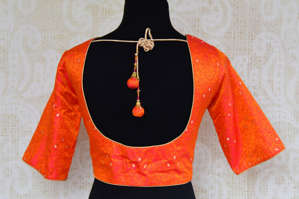 Buy bright orange Banarasi silk saree blouse online in USA. Pure Elegance clothing store brings an exquisite range of Indian saree blouses in USA for women. Shop online.-back