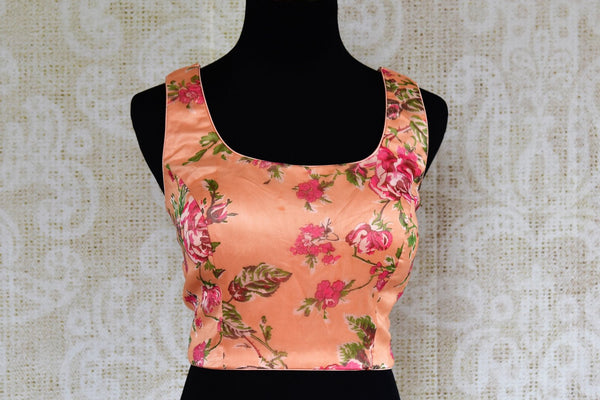 Buy peach floral print organza saree blouse online in USA. Pure Elegance clothing store brings an exquisite range of Indian designer saree blouses in USA for women. -front