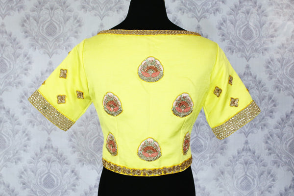 Lemon yellow embroidered saree blouse buy online in USA. Shop from a range of latest Indian designer saree blouses at Pure Elegance clothing store for women.-back