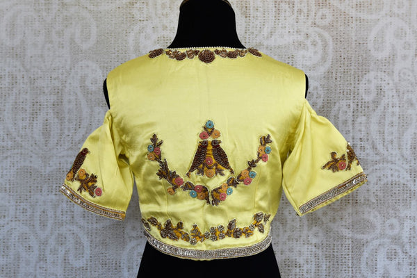 Lemon yellow embroidered cold shoulder sari blouse buy online in USA. For an elegant Indian style, choose designer saree blouses at Pure Elegance store to match your sarees.-back