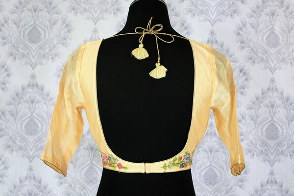 Buy cream embroidered saree blouse online in USA. Pure Elegance Indian clothing store brings an exquisite range of readymade saree blouses in USA to complement your Indian saris. Add spark to your traditional look with elegant saree blouses at every occasion.-back