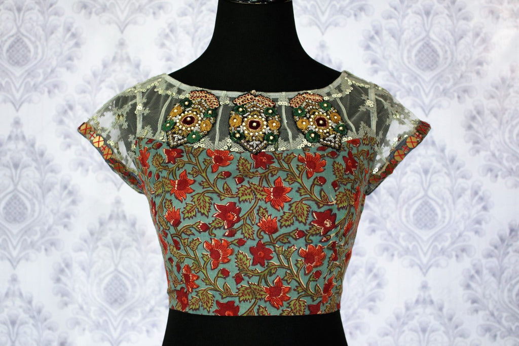 Buy green printed designer sari blouse with embroidery online in USA. Pure Elegance Indian clothing store brings an exquisite range of designer blouses in USA to match your gorgeous Indian sarees. Add spark to your traditional look with elegant saree blouses at every occasion.-front