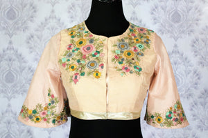 Buy peach saree blouse with embroidery online in USA. Pure Elegance Indian clothing store brings an exquisite range of designer blouses in USA to match your gorgeous Indian sarees. Add spark to your ethnic look with stylish saree blouses for every occasion.-front