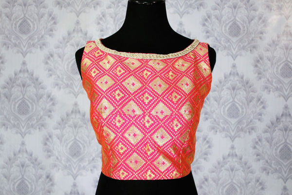 Buy pink designer sleeveless saree blouse online in USA. Pure Elegance Indian clothing store brings an exquisite range of designer blouses in USA to match your gorgeous Indian sarees. Add spark to your ethnic look with stylish saree blouses for weddings and parties.-front