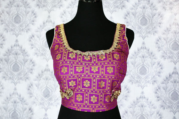 Buy purple embroidered sleeveless saree blouse online in USA. Pure Elegance Indian clothing store brings an exquisite range of readymade saree blouses in USA to match your gorgeous Indian saris. Add spark to your ethnic look with stylish sari blouses for weddings and parties.-front